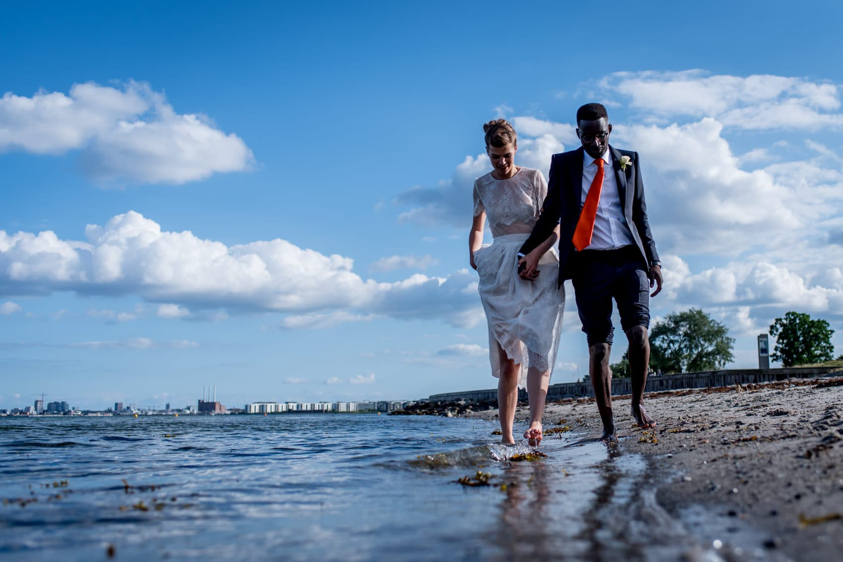 Copenhagen Wedding Photographer with the bride and groom by the water